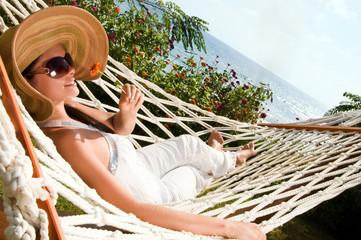 Young woman in hammock