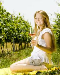 woman at a picnic in vineyard
