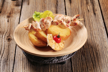 Chicken kebab and roasted potato