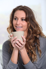 Portrait of woman holding cup of tea
