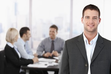 Portrait of businessman in meeting room