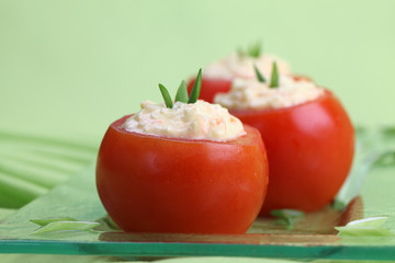 Stuffed tomatoes with cheese, egg and carrot spread