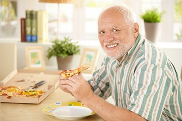 Portrait of senior having pizza