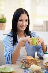 Portrait of young woman at breakfast