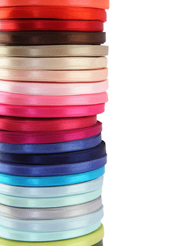 Colored spools of ribbon isolated on white