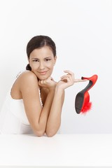 Attractive girl posing with high heel red slippers