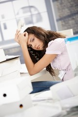 Young secretary having headache in office