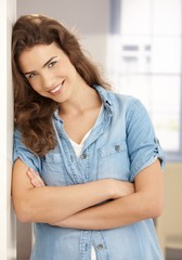 Happy female smiling arms crossed