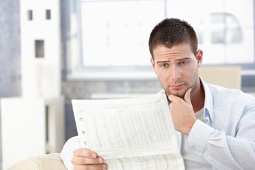 Young man reading bad news