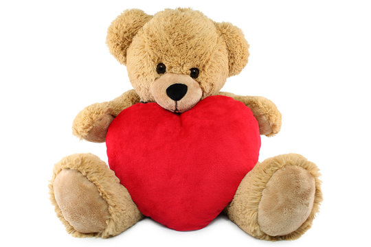 Ours brun en peluche et coeur rouge