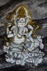 Paintings of Ganesh at the old wooden door.