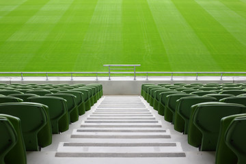 Poster de jardin Stade de football Rows of folded, green, plastic seats in very big, empty stadium