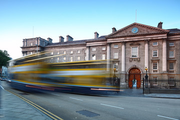 Trinity College at day in Dublin, Ireland. Bus quickly rides