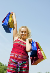girl with Coloured Shopping bags
