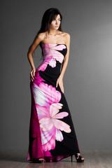 beautiful fashionable woman in pink dress