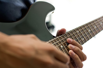 The Electric Guitar and the player's hands