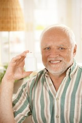 Older man presenting medication
