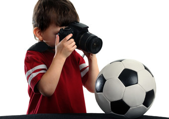 Child with photo camera and soccer ball