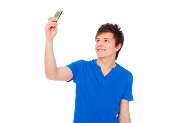 young man taking picture on phone