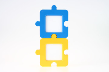 Couple of Vertical Jigsaw-Shape Photo Frame in Blue and Yellow