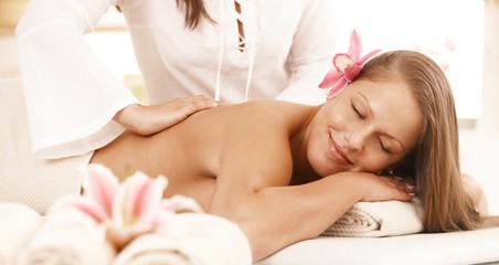 Smiling woman enjoying back massage