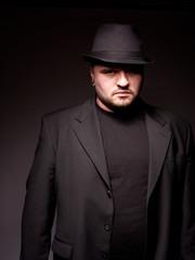 Man in black.