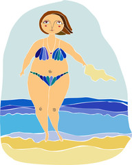 woman in a dark blue bikini on a beach