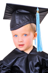 Cute little boy in graduation gown