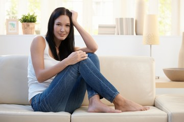 Pretty woman posing on couch