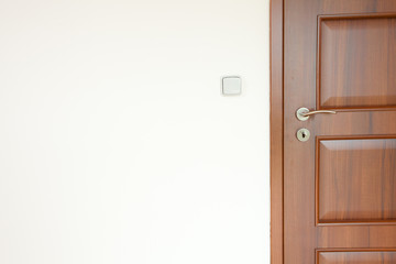 wooden door with a handle in a white room