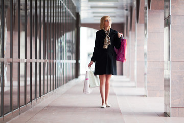Young woman against a shopping mall