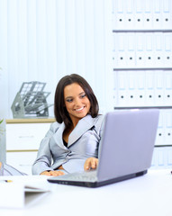 young businesswoman working on laptop computer a
