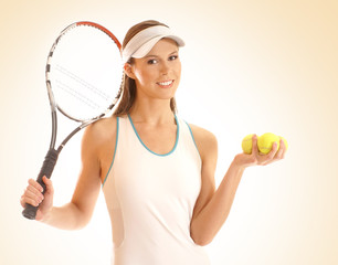 A young and sporty woman with tennis equipment