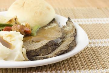 detail of sliced roast beef dinner