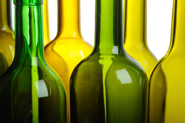 Many empty green wine bottles isolated on white background