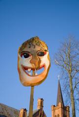 Mardi Gras mask on sky background