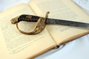 Age-old  sword on a book
