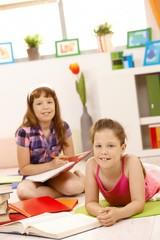 Portrait of girls doing homework