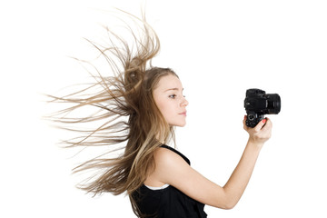 A young woman with a photo camera