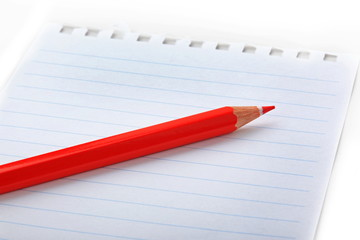The notepad and red pencil