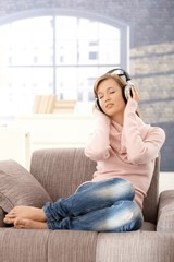 Young woman listening music at home