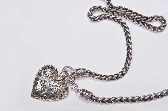 Silver heart closed - jewelery on white background