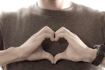 Man Making Heart Shape with Hands Near Chest