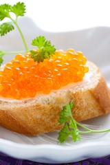 Party snack with red caviar