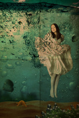 beauty young woman in dress under water, vintage,