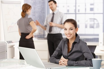 Attractive businesswoman smiling happily in office