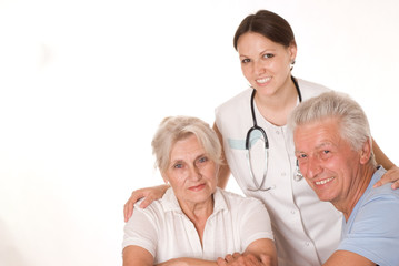 woman doctor and an elderly couple