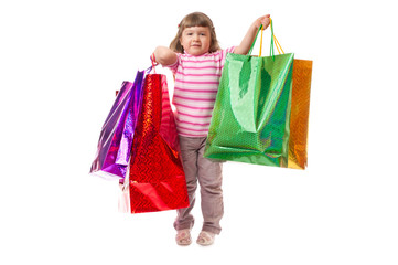 Little smiling girl with bags