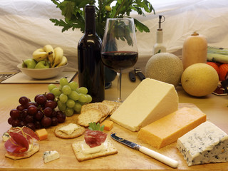 Selection of cheese and crackers with wine and a cheese knife