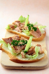 sandwich with tuna and cucumbers on the board